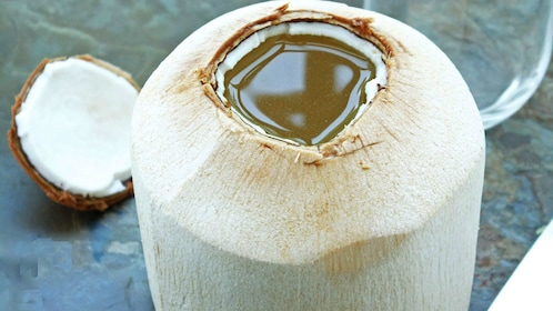 Cut open coconut from street vendor in Penang