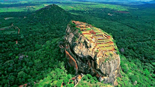 Aerial view of Sigiriya Rock Fortress and surrounding forest in Sri Lanka