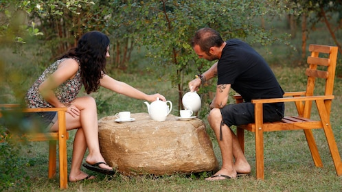 Couple having tea at a campsite in Sri Lanka