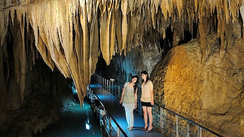 Two girls looking at rock formations in Okinawa World cave