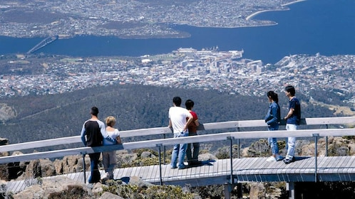 People on a boardwalk on Mount Wellington looking out at the view below in Australia