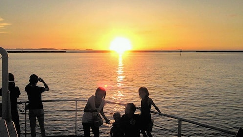 Silhouette of boating passengers at sunset in Naha