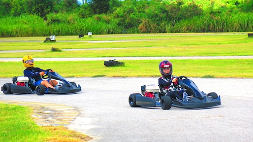 People driving on a Go Kart course