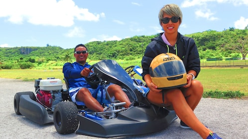 Two people pose on Go Karts in Saipan