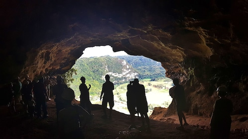 Tour group view out of cave opening will on cave ecotour in Puerto Rico