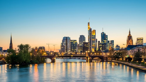 View of skyline from river at dusk in Frankfurt