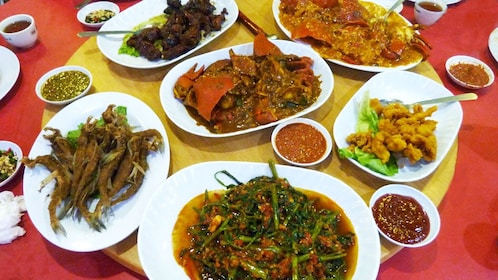 Table of different cuisine on food tour in Kuala Lumpur