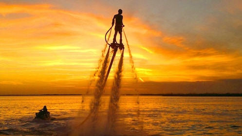Person on a Flyboard at sunset