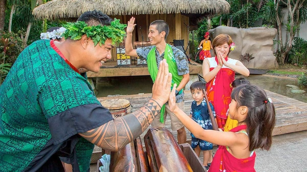 Show item 4 of 5. Family at the Polynesian Dinner Show in Guam