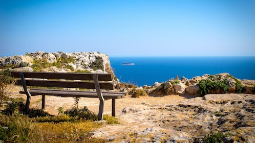A bench looking out at the coast of Malta