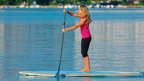 Paddle boarding woman in Delaware
