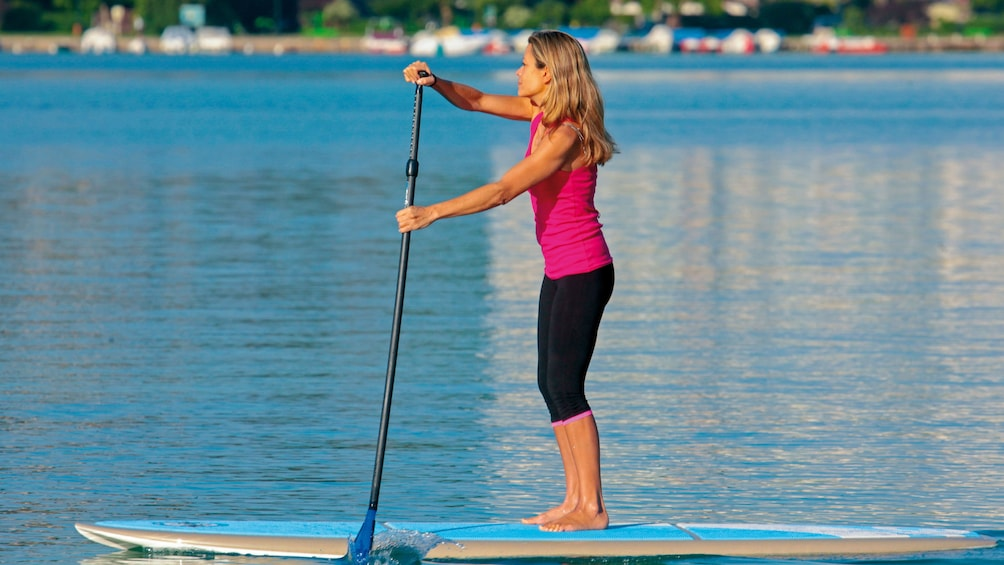 Show item 1 of 6. Woman paddle boarding