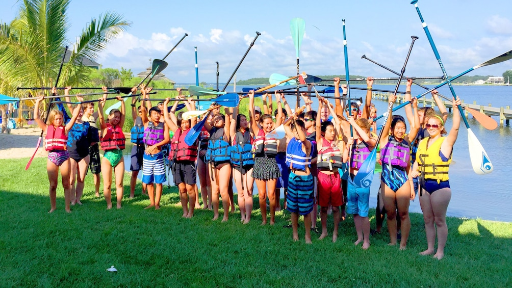 Show item 3 of 6. Paddle boarding group