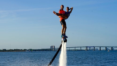 Couple using flyboard in Miami