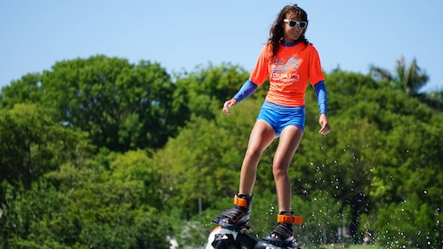 Girl using flyboard in MIami