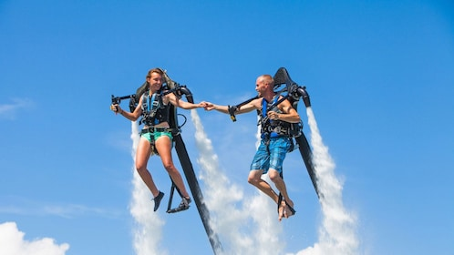 Couple using a jetpacks in Miami