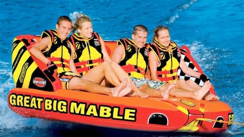 Group having fun on the Banana Boat Experience in Miami