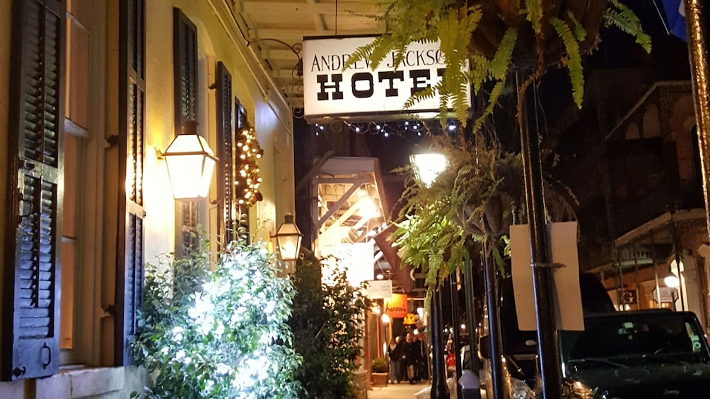 Show item 5 of 5. View of Andrew Jackson Hotel at night in New Orleans