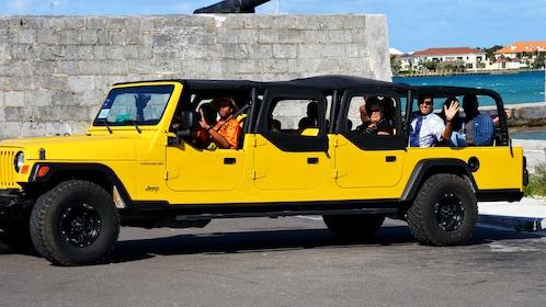 Tour group sit in jeep near beach in Nassau