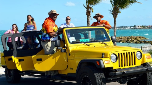Tour group stand in jeep at beach in Nassau