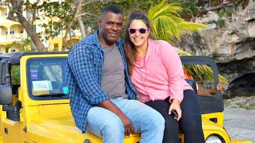 People sitting on jeep for photo in Nassau