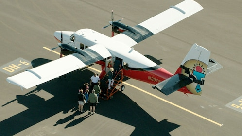 Passengers boarding the airplane for the aerial tour of the Grand Canyon & Mojave Desert
