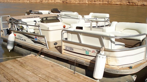 Close up of white pontoon boat near dock in Grand Canyon