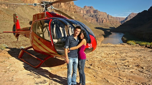couple posing by helicopter in nevada