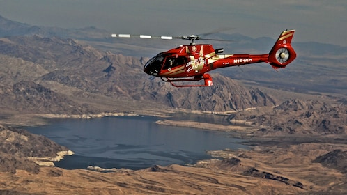 Helicopter flying over lake in Nevada