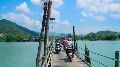 Scooters closely pass by one another in bridge in Nha Trang