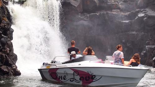 Tour speedboat near waterfall in Mauritius