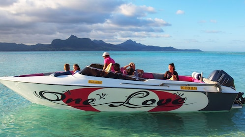 Tour speedboat float on clear waters in Mauritius