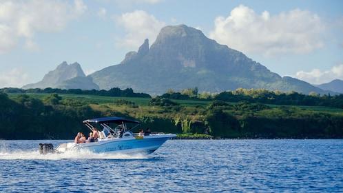 Tour boat cruising across water in Mauritius