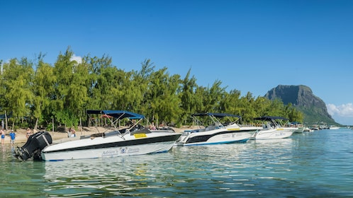 Tour boats lined up at beach in Mauritius
