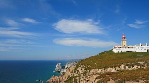 Lighthouse along coastal cliffs in Sintra