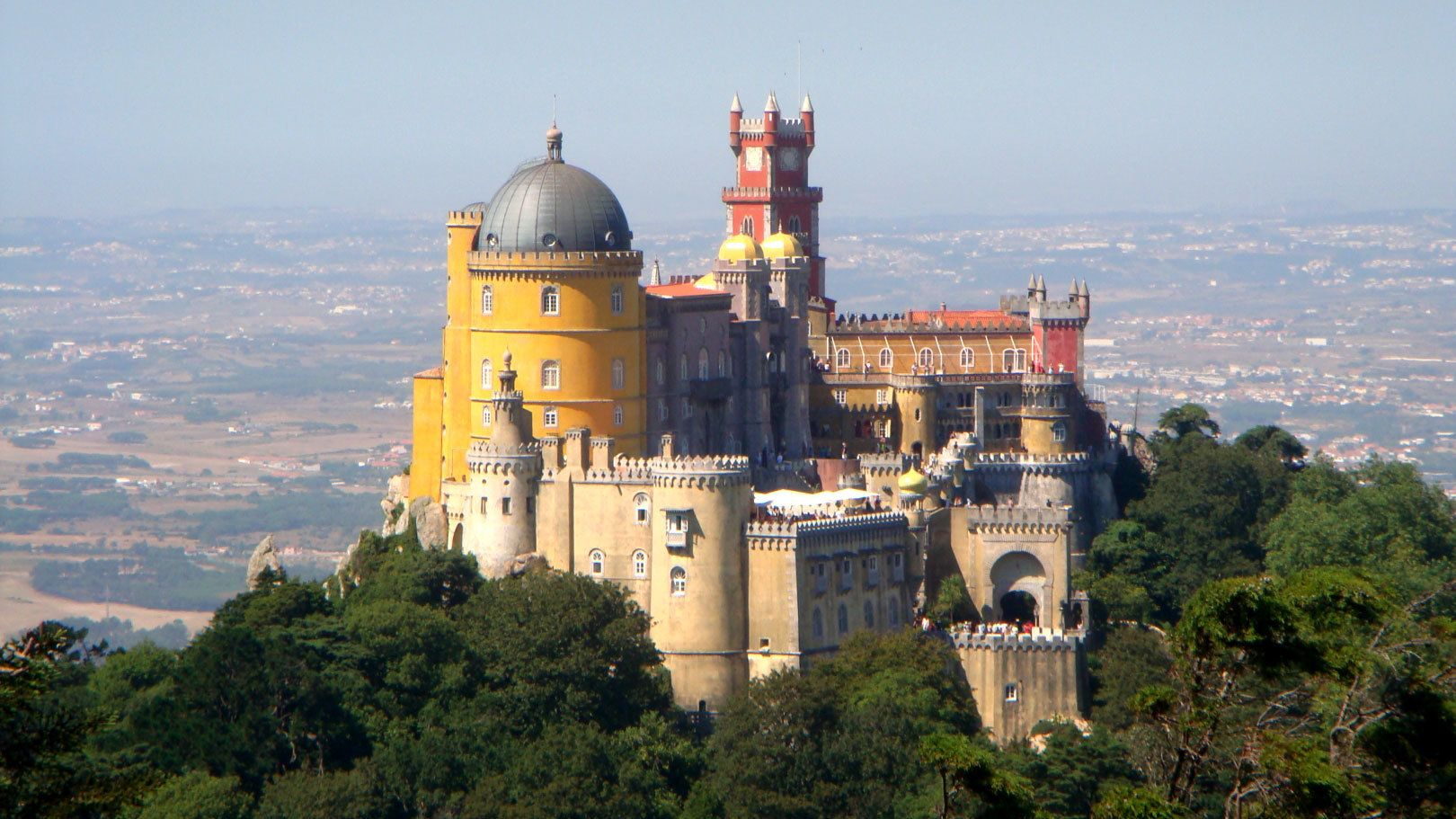 Large castle on peak of hill overlooking Sintra