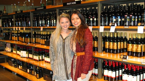 Two women pose in a New Zealand winery