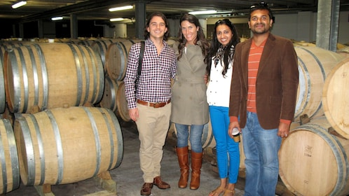 Group in wine cellar of winery in Auckland