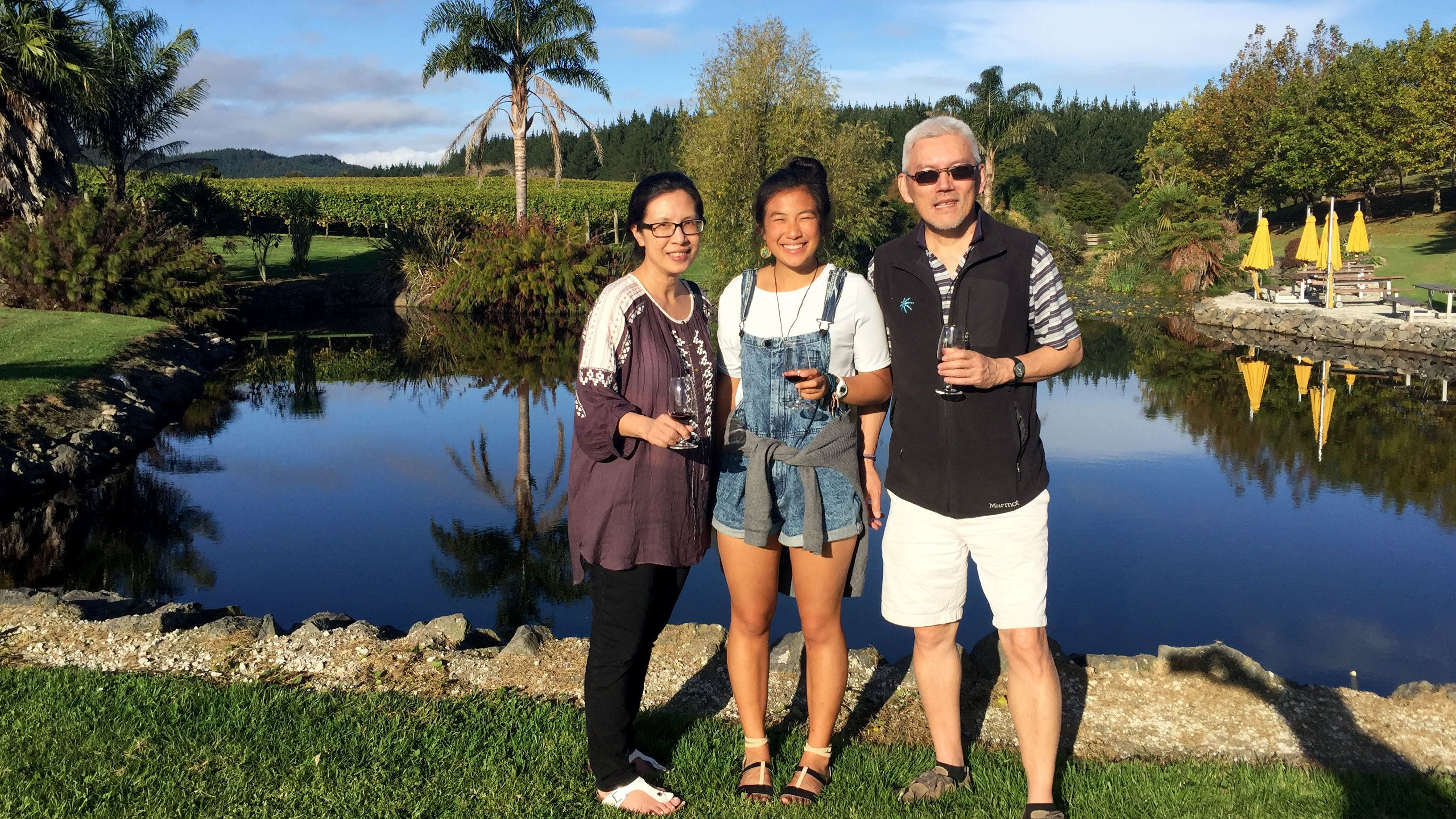 Family standing near pond at winery in Auckland