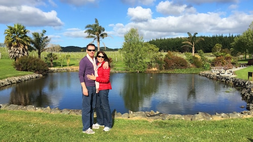 Couple standing near pond at winery in Auckland