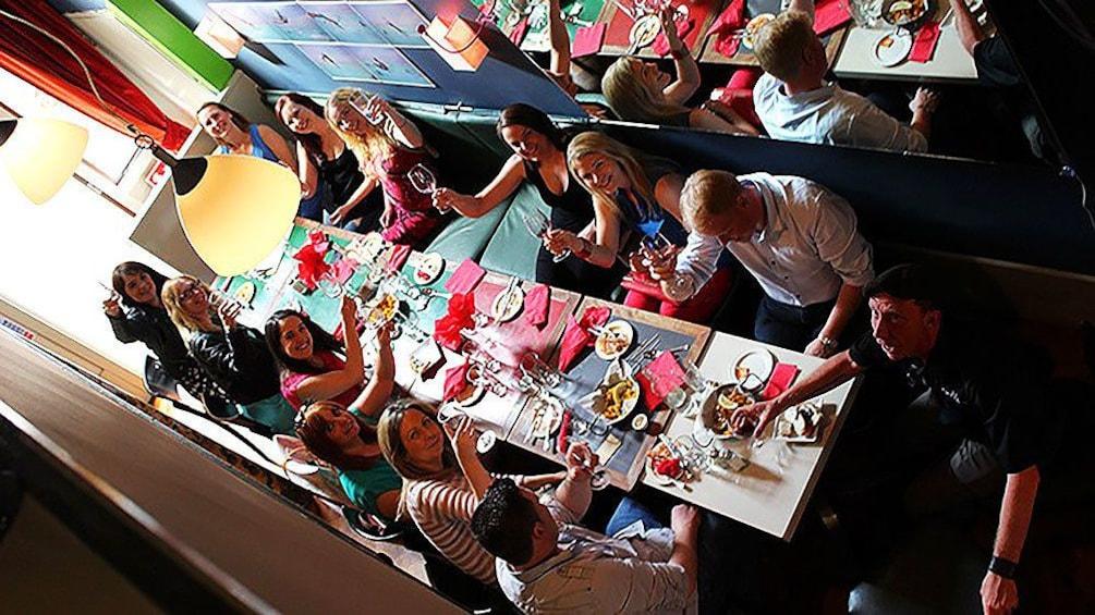 Show item 2 of 5. Large group enjoying food during tapas tour in Galway