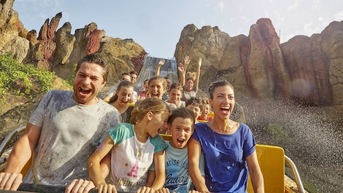 Family on a roller coaster at PortAventura theme park in Barcelona