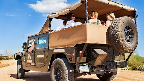 Passengers in the back of a Hummer in Arizona