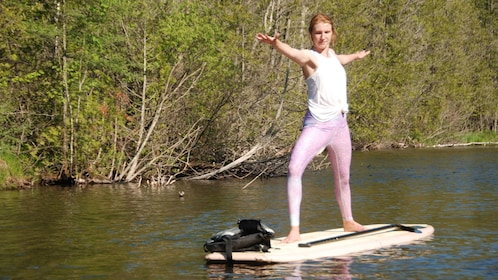 Woman doing yoga on paddle board in Austin