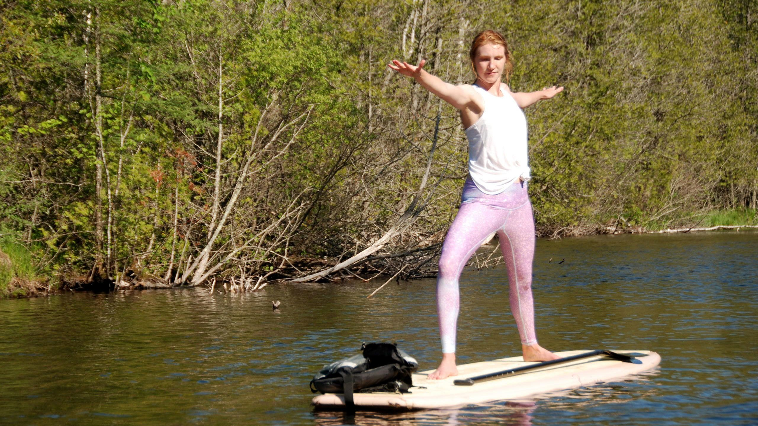 Woman doing yoga on a paddle board in Austin