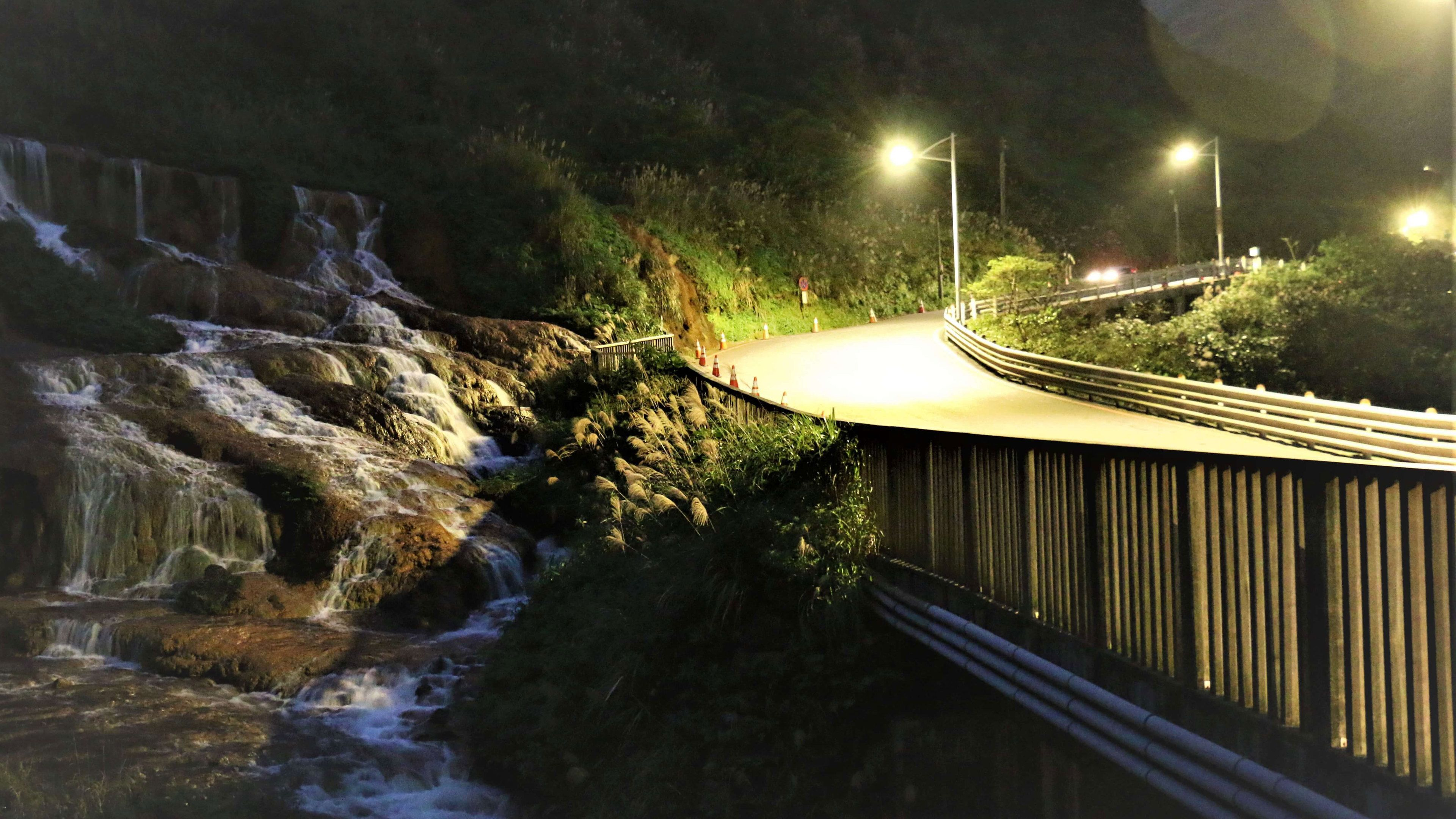 Road skirting past water fall in Jiufen