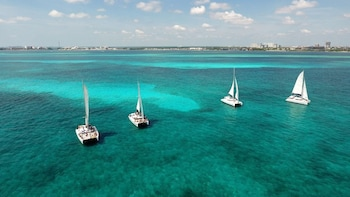 Isla Mujeres Catamaran Adventure with Private Beach Club