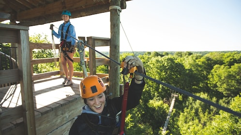 Two girls zipline in Minneapolis