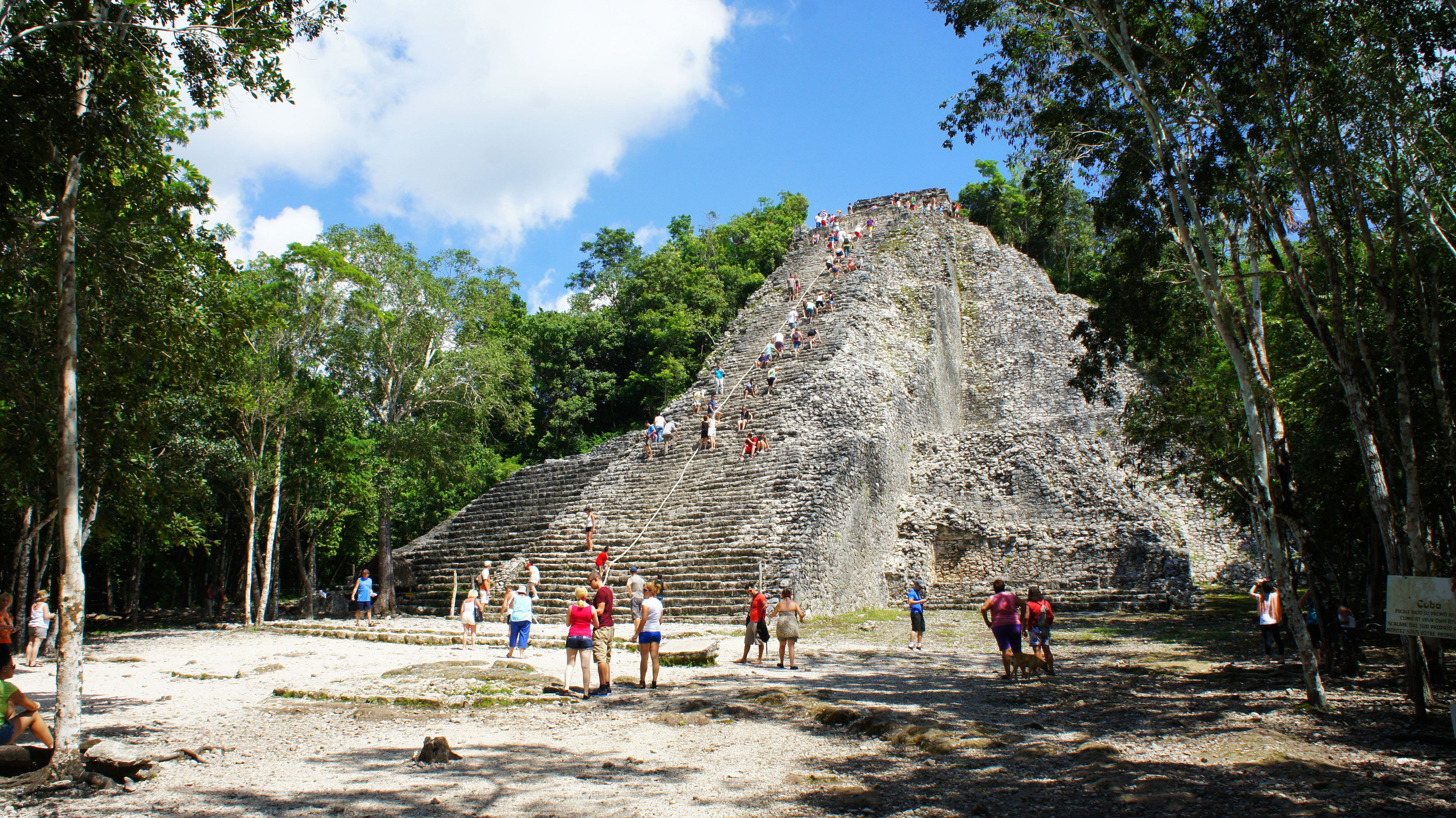 Tourists at temple ruins in Tulum