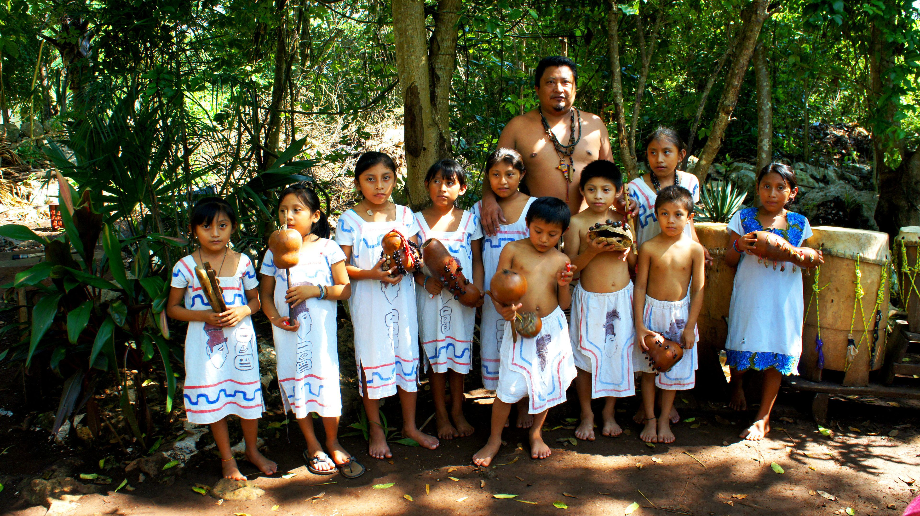 Children with musical instruments from the villages of Coba